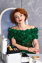 A pretty woman russian irina from mariupol with Red hair age 40